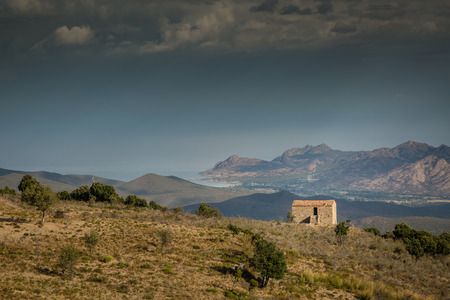 Farmhouse in the hills overlooking the Desert des Agriates in the Balagne region of Corsica photo