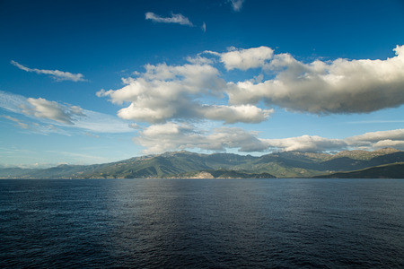 corse: Blue skies and clouds over the eastern coast of Cap Corse in Corsica Stock Photo