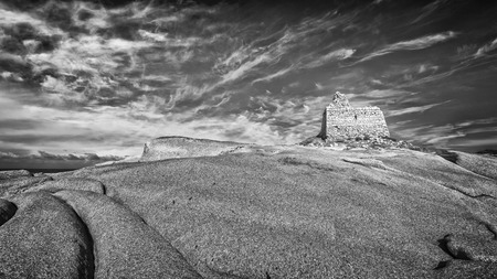 genoese: Ruined Genoese tower overlooking the mediterranean on rocks at Punta Caldanu near Lumio in Balagne region of Corsica Editorial