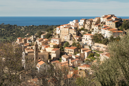 The houses and rooftops of the village of Lumio in the Balagne region of north Corsica Stock Photo