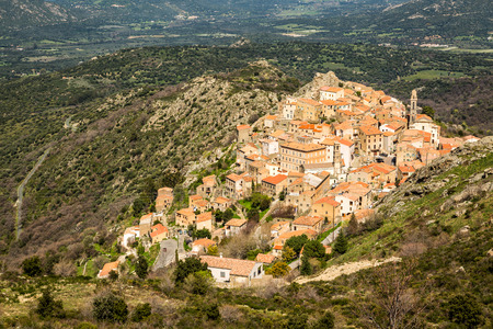 the crags: The mountain village of Speloncato built on rocks in the Balagne region of north Corsica and surrounded by maquis
