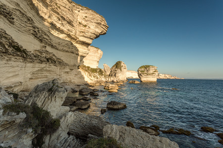 mediteranean: The towering white cliffs and stacks in the Mediteranean at Bonifacio in the south of Corsica with Sardinia in the background Stock Photo