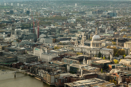 st pauls cathedral: Overhead view of St Pauls cathedral and the skyline of London in England with the river Thames in the foreground
