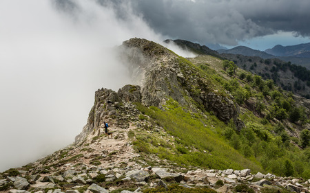 lac: Clouds and mist meet the top of a mountain ridge on the GR20 track near Lac de Nino in Corsica Stock Photo