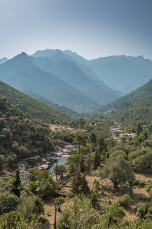 receding: Fango valley in northern Corsica near to Galeria with the river in the foreground and overlapping mountains receding into the distance Stock Photo