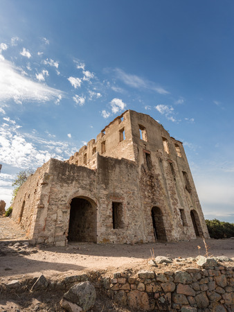 bonaparte: Derelict chateau of Pierre-Napoleon Bonaparte at Torre Mozza between Calvi and Galeria with mountains, coastline and blue skies in the background Stock Photo