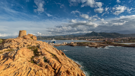 out of town: Genoese tower looking out over the town of Ile Rousse from La Pietra in the Balagne region of Corsica Stock Photo