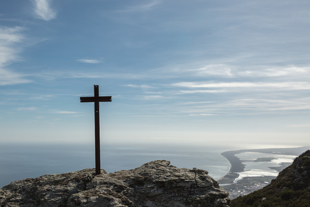 christian religion: Rough iron cross in the rock looking out over the east coast of Corsica Stock Photo