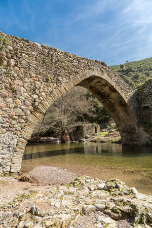 genoese: Stream passing through an ancient Genoese bridge in the village of Piana in the Balagne region of Corsica Stock Photo