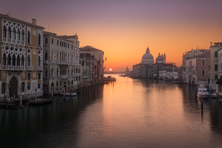 santa maria: Beautiful sunrise over the Grand Canal in Venice looking  towards the Basilica di Santa Maria della Salute Stock Photo