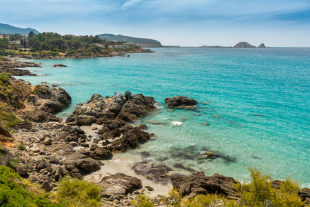 Translucent turquoise sea, rocky coastline and beach near to Ile Rousse in the Balagne region of Corsica Stock Photo