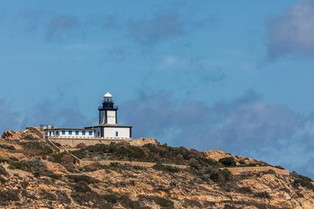 Revellata lighthouse looking on the west coast of Corsica near Calvi Stock Photo