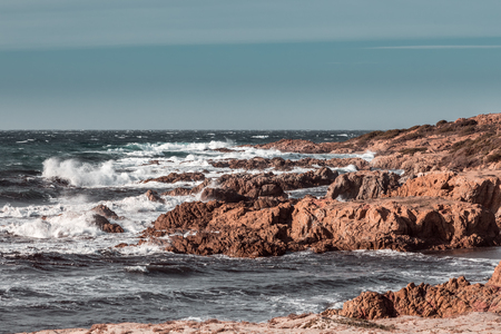 Rough seas and jagged rocks on the coast of the Desert des Agriates at Ostriconi in the Balagne region of Corsica