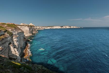 White cliffs and citadel of Bonifacio in Corsica above the turquoise Mediterranean sea Stock Photo