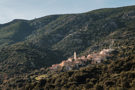 Afternoon sunshine on the ancient mountain village of Palsasca in the Balagne region of Corsica Stock Photo