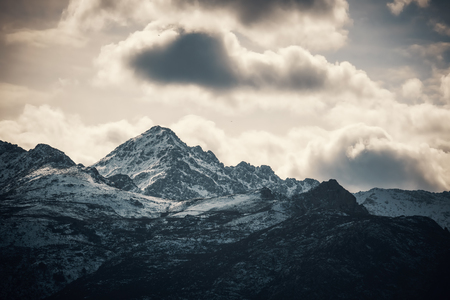 Snow capped mountain peak of Monteo San Parteo in the Balagne region of Corsica Stock Photo