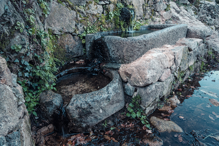 Two ancient stone water troughs in the hills of the Balagne region of Corsica