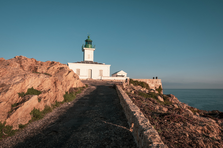Lighthouse on La Pietra rock at Ile Rousse in the Balagne region of Corsica Stock Photo