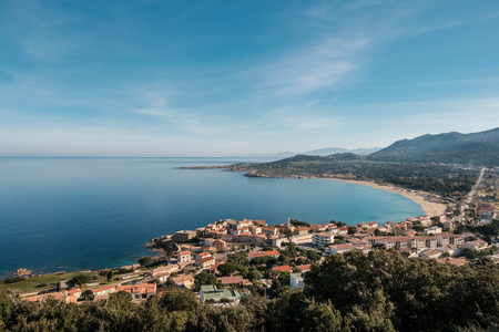 View of the village of Algajola, sandy beach and turquoise Mediterranean sea in the Balagne region of Corsica Stock Photo