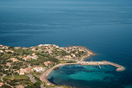 View looking down on the small port of San Damiano and turquoise Mediterranean sea in the Balagne region of Corsica