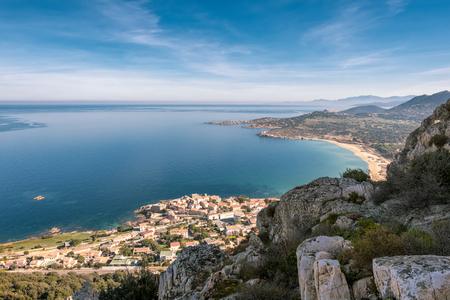 View from rocky hills of the village of Algajola, sandy beach and turquoise Mediterranean sea in the Balagne region of Corsica