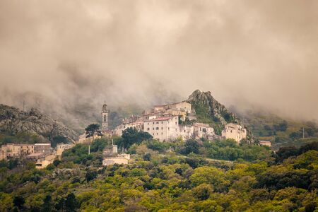 Dark clouds hanging over the ancient mountain village of Speloncato in the Balagne region of Corsica