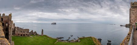 Panoramic view from the ramparts of Tantallon Castle in East Lothian in Scotland over the inner courtyard and across the Firth of Forth towards Bass Rock