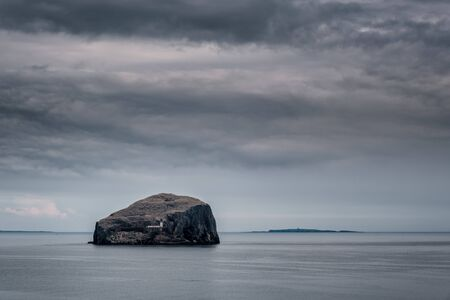 Dark clouds over the lighthouse on Bass Rock in the Firth of Forth near North Berwick on the east coast of Scotland