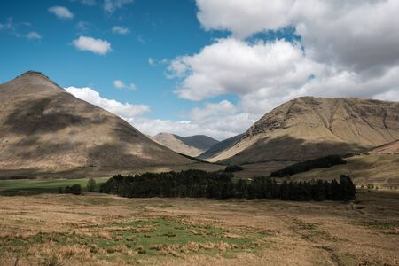 Beinn Dorain and Beinn aChaisteil mountains near to Tyndrum in the Highlands of Scotland with Beinn aChreachain and Beinn Mhanach in the distance