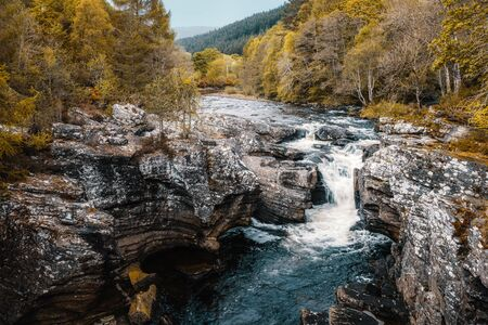 River Morison Falls at Invermoriston in Scotland surrounded by woodland