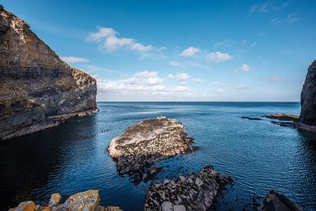 Steep cliffs and rocks at the entrance to Whaligoe Harbour near Wick in Caithness in Scotland