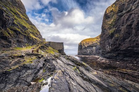 An old hand powered boat winch on the rocks at the entrance to Whaligoe Harbour near Wick in Caithness in Scotland