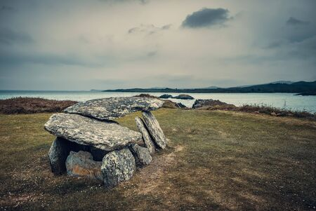 Neolithic wedge tomb at Altar overlooking Toormore Bay in County Corkon the south west coast of Ireland