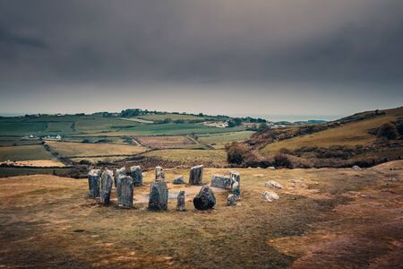 Dark clouds over the standing stones of Drombeg stone circle near Glandore in County Cork in Ireland 写真素材