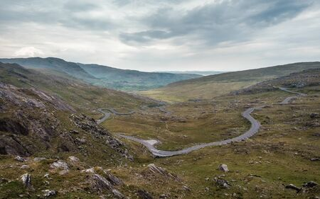 View of the Healy Pass as it winds its way through the valley on the Beara peninsula in County Cork in Ireland