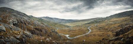 Panoramic view of the Healy Pass as it winds its way through the valley on the Beara peninsula in County Cork in Ireland