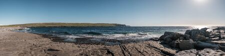 Panoramic view of the Cliffs of Moher in County Clare on the west coast of Ireland from the rocky coastline at Doolin