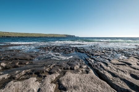 View of the Cliffs of Moher in County Clare on the west coast of Ireland from the rocky coastline at Doolin