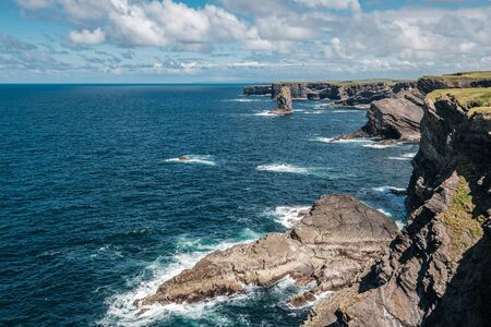 Kilkee cliffs and stacks face the Atlantic ocean on the west coast of Ireland