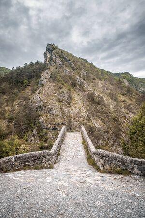 Pont de la Reine Jeanne is a narrow 16th century stone bridge over the Coulomp river near Saint-Benoit in the Alpes-de-Haute-Provence region of France
