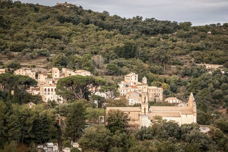 The ancient mountain village of Ville di Paraso in the Balagne region of Corsica under dark storm clouds Stock Photo