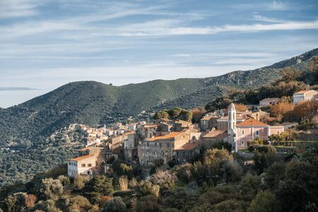 Ancient mountain village of Costa in the Balagne region of Corsica with Belgodere in the distance