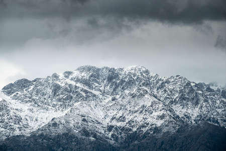 Snow capped peak of Monte Grosso standing at 1937 metres in the Balagne region of Corsica