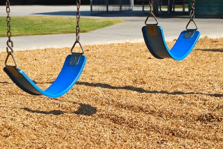 this a close up shot of two playground swings photo