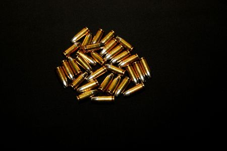 this is a close up shot of a pile of bullets