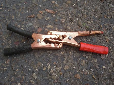 this is a close up shot of jumper cable clamps