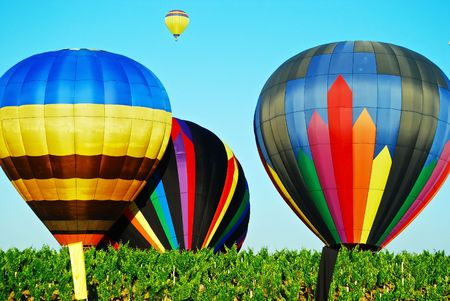 this is a shot of four hot air balloons