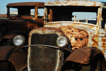 rusty car: this is a shot of two old trucks
