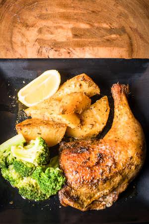 chicken lemonato greak style with vegetables and potato