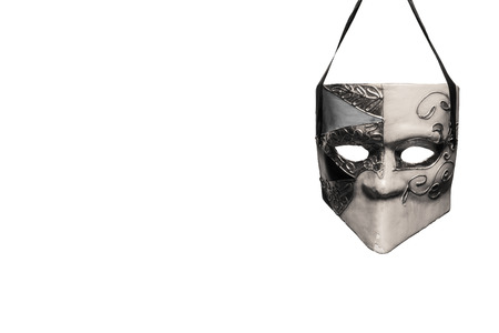 masquerade masks: Venetian style masquerade mask in black and white hanging in front of a white background